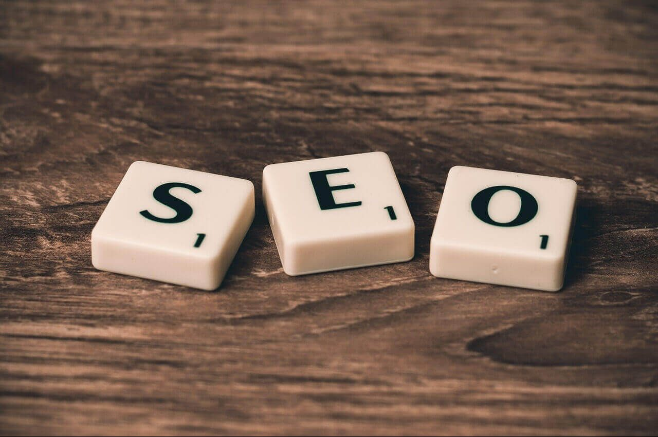 The word SEO formed by scrabble